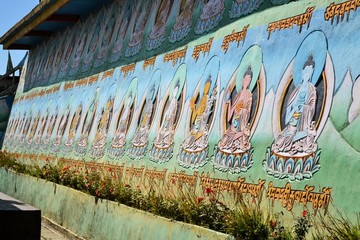 Colorful Buddhas on temple wall, Nepal