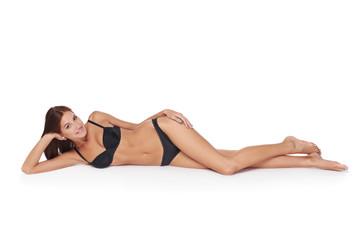 Woman lying down in lingerie