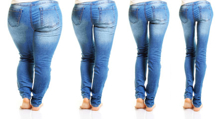 Woman in blue jeans isolated on white background