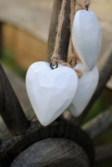 wooden white hearts on the string