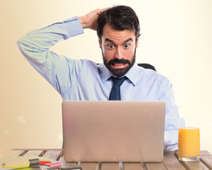 Businessman in his office having doubts