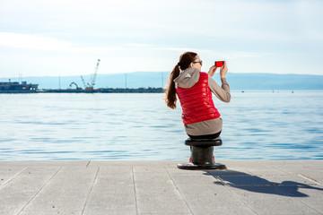 Sport woman on the promenade