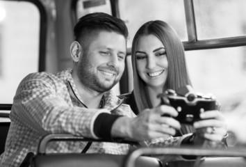 young couple taking fun photos on the camera. Black & white