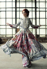 elegance woman with flying dress in palace room
