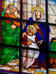 Wall Mural - Stained glass window of the Child Jesus and Mary and Joseph