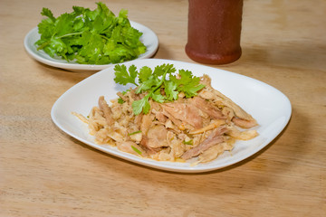 Shredded boiled chicken with coriander on white dish