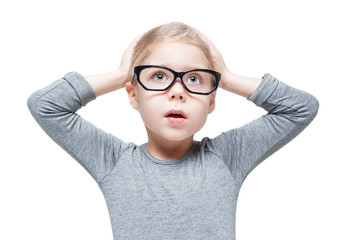 Excited beautiful little girl in glasses isolated