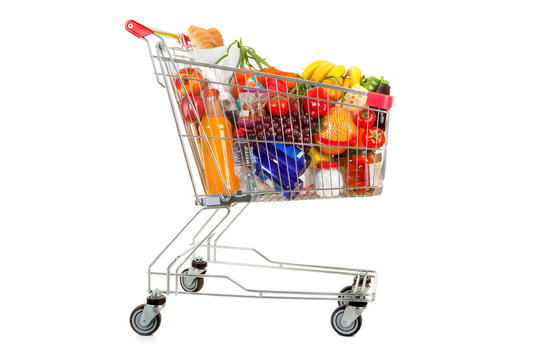 Shopping Trolley of Food on White Background.