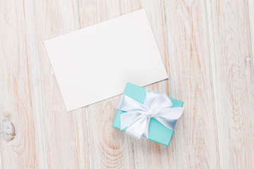 Gift box and blank photo frame or greeting card