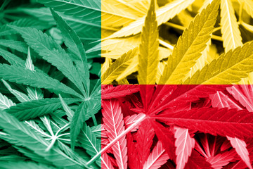 Benin Flag on cannabis background. Drug policy.