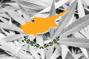 Cyprus Flag on cannabis background. Drug policy.
