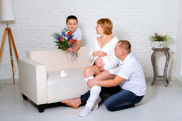 Pregnant woman and her family at home