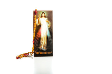 Merciful Jesus with blank ribbon and Rosary beads