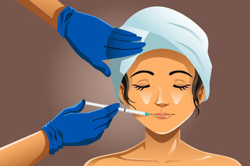 Woman receiving beauty treatment