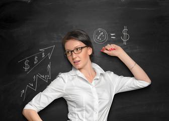 Nice girl posing near the blackboard