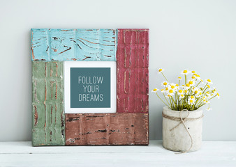 colored retro frame with place for text with chamomile