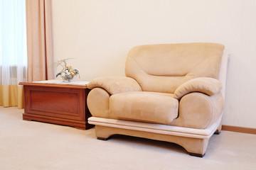 Beige chair in hotel room