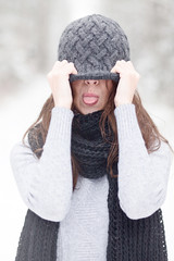 beautiful brunette girl in winter hat hipster