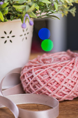 Ball of knitting yarn with flowers