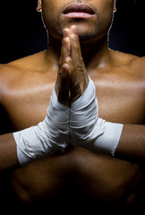 mma fighter preparing to fight  by praying with hands clasped