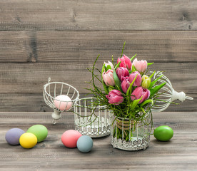 Pink tulip flowers and colored easter eggs. Retro style picture
