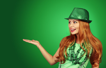 St Patricks day Girl. Cheerful young woman wearing green hat