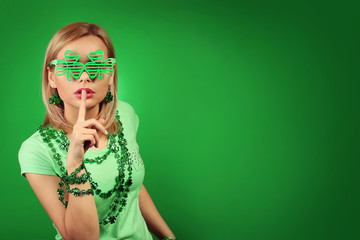 St Patrick's day Girl. Young woman with shamrock shaped glasses