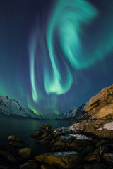 Fototapete - Incredible Aurora Borealis over night sky in Arctic