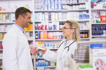 Team of pharmacists holding medecines