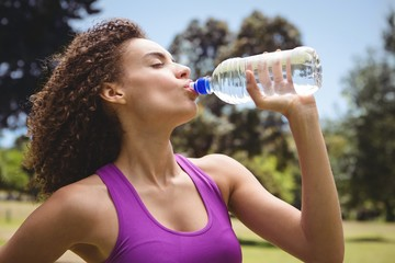 Fit woman taking a drink