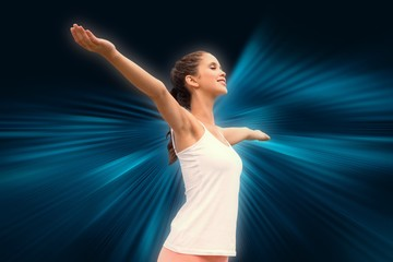 Composite image of beautiful woman with arms raised against sky