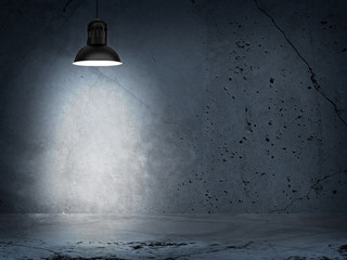 Concrete gray wall and lamp with directional light