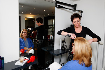 hairdresser and client in front of the hairdresser mirror