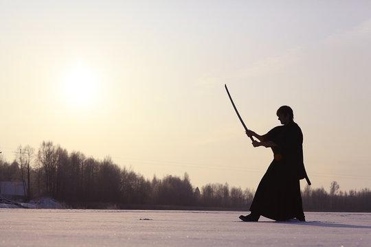 Black oriental martial arts warrior winter training