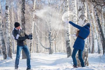 Couple walking in winter forest