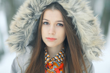 Urban portrait of a young girl outside in winter