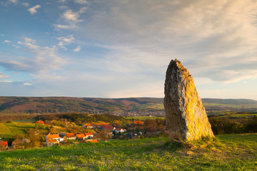 Menhir on the hill at sunset in Morinka village Wall mural