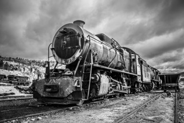 Old abandoned locomotive train, dramatic black and white version