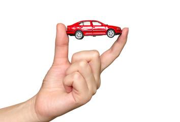 Fingers holding red car model