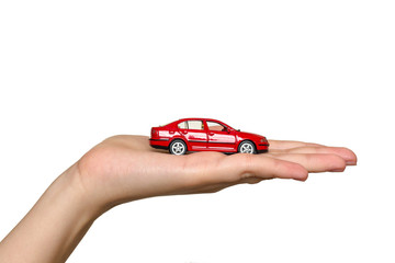 Women holds red car on the palm
