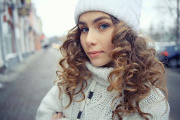 portrait of a beautiful blonde winter outside