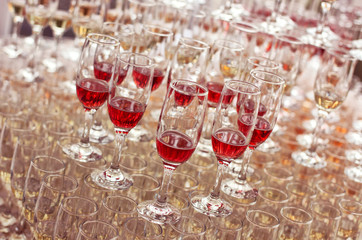 Wedding glasses filled with wine and champagne