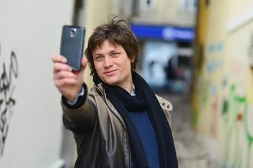 City hipster making selfie