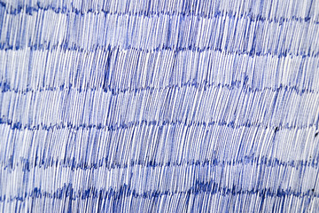 Blue ballpoint pen on white paper, texture or background