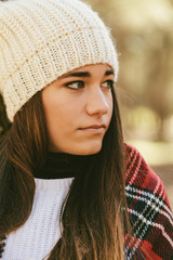 Portrait of a Cute Young Woman with Winter Clothes