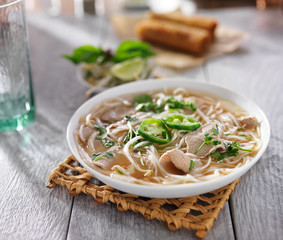 hot bowl of vietnamese pho with sliced beef