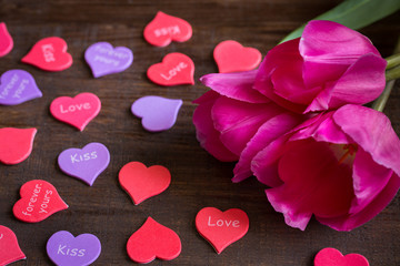 bouquet of flowers on the table with hearts