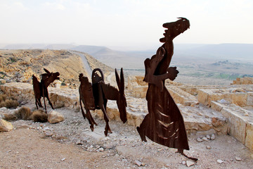 Farm animals and human statues in the Negev desert, Avdat ,