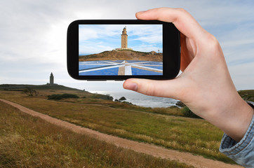 tourist taking photo of lighthouse Tower of Hercules