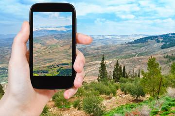 tourist taking photo of Promised Land